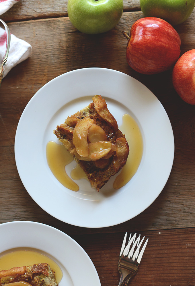 Plate with a slice of Baked Apple French Toast with maple syrup