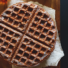 Top down shot of a Blue Cornmeal Waffle on a napkin