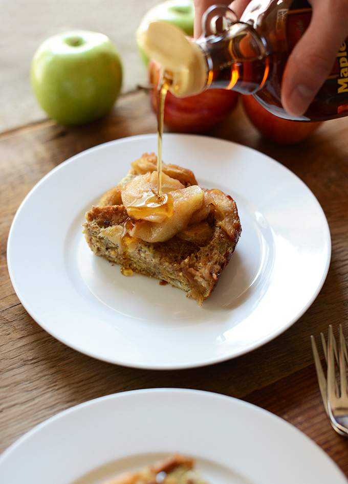 Drizzling maple syrup onto a slice of our Cinnamon Apple French Toast Bake