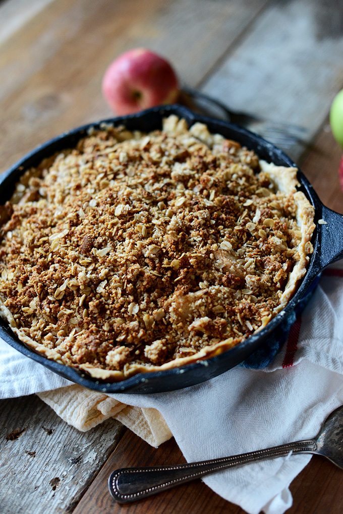 Cast-iron skillet filled with our Deep Dish Apple Crumble Pie