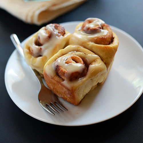 Plate of Simple Vegan Cinnamon Rolls with icing