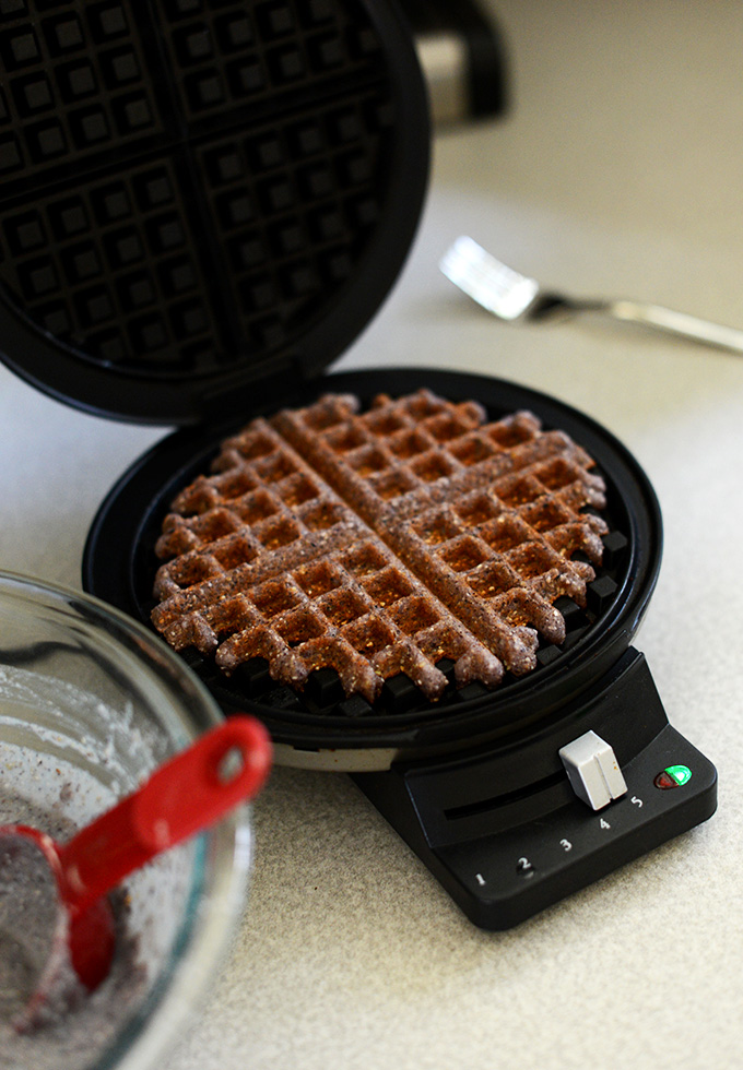 Freshly cooked Gluten-Free Vegan Cornmeal Waffle in a waffle iron
