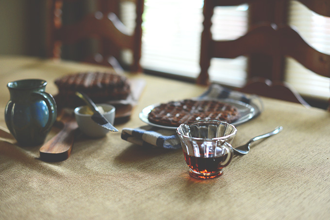 Table with Gluten-Free Waffles, syrup and butter for a delicious breakfast