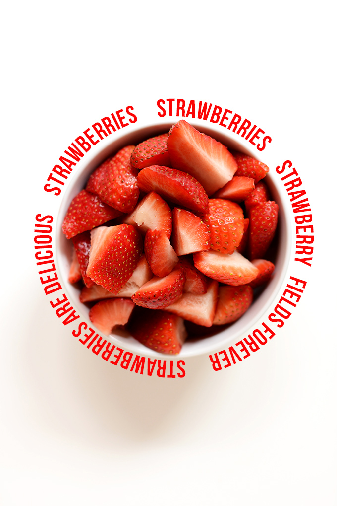 Bowl of sliced strawberries surrounded by text for our guide on How to Wrap Text in a Circle