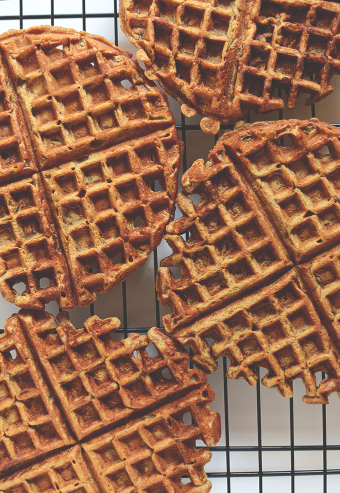 Homemade Pumpkin Spice Waffles cooling on a baking rack