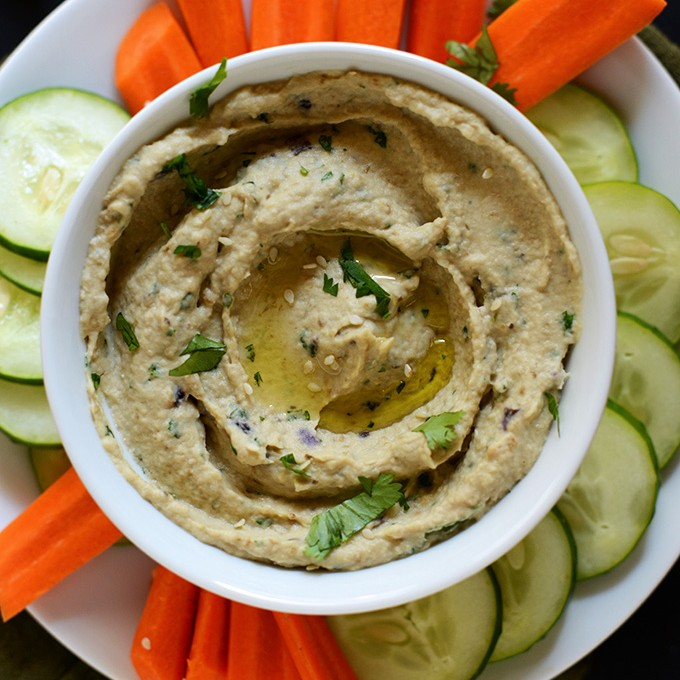 Sliced vegetables and a bowl of Baba Ganoush for a simple Mediterranean appetizer