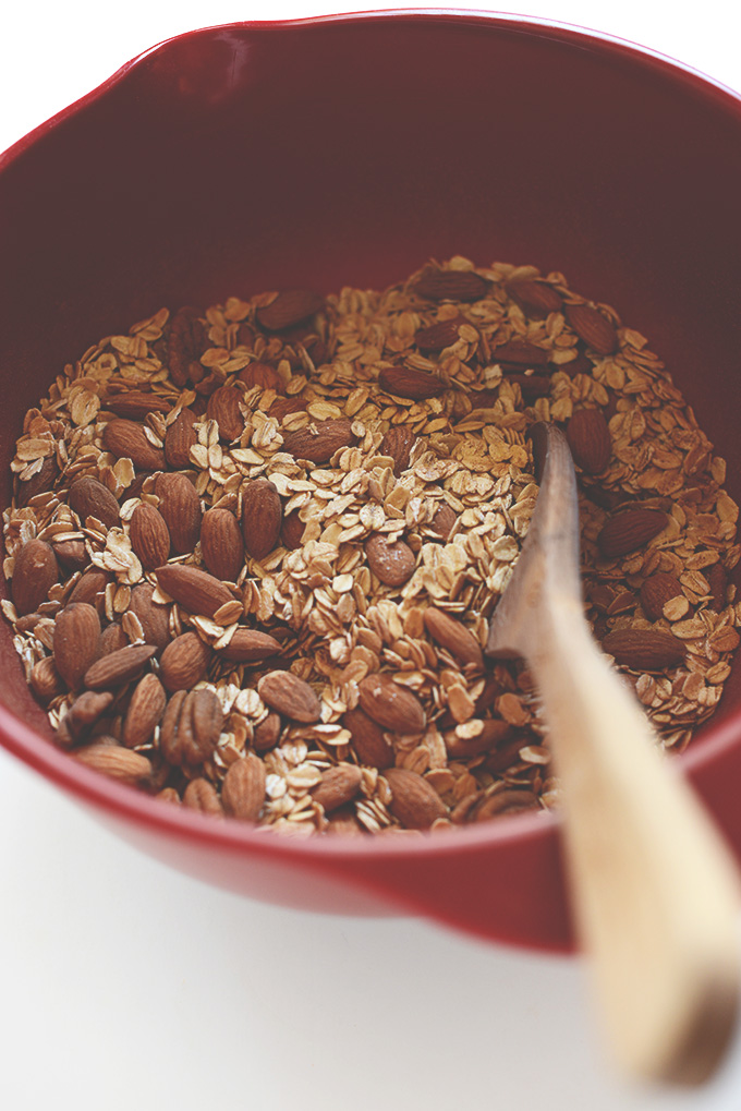 Mixing oats and almonds in a bowl for homemade Sweet Potato Granola