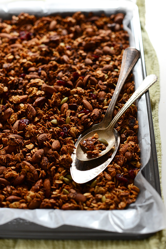 Parchment-lined baking sheet with a batch of our Sweet Potato Granola recipe