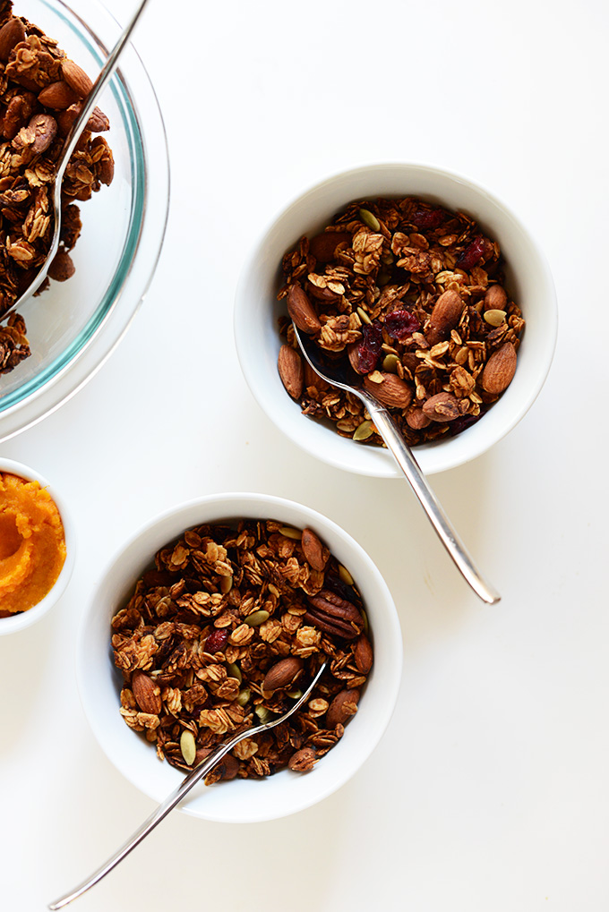 Bowls of the perfect fall granola made with cranberries and pepitas