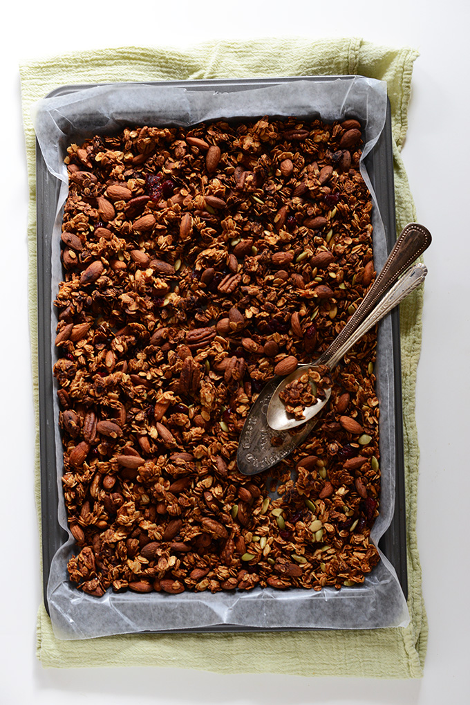 Parchment-lined baking sheet filled with a batch of our Sweet Potato Granola recipe