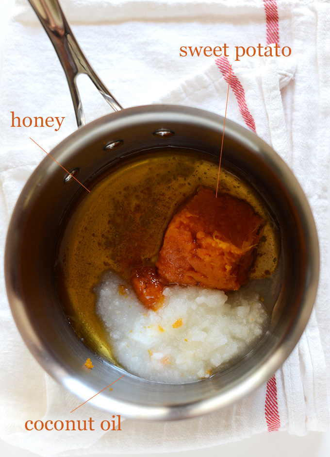 Coconut oil, honey, and sweet potato in a saucepan
