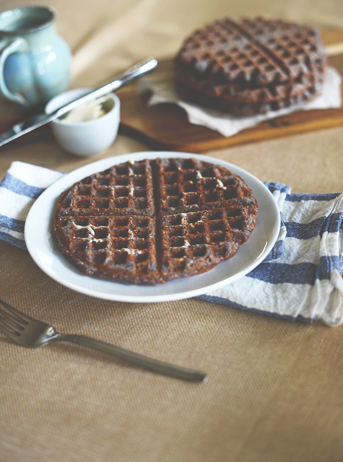 Plate and cutting board with our Vegan and Gluten-Free Blue Cornmeal Waffles