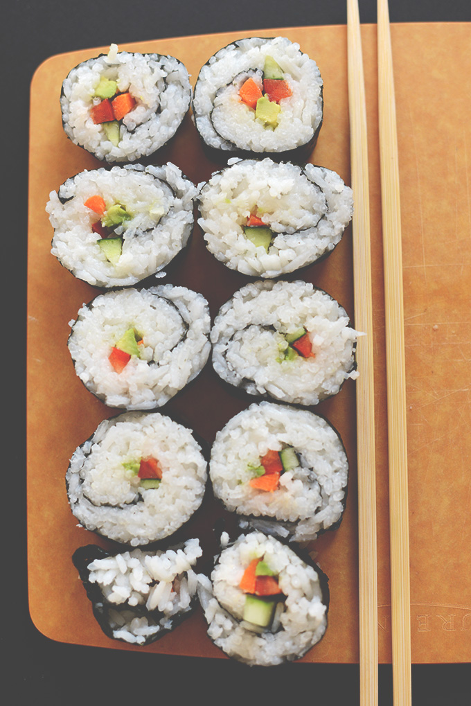 Cutting board filled with homemade Vegan Sushi made without a mat