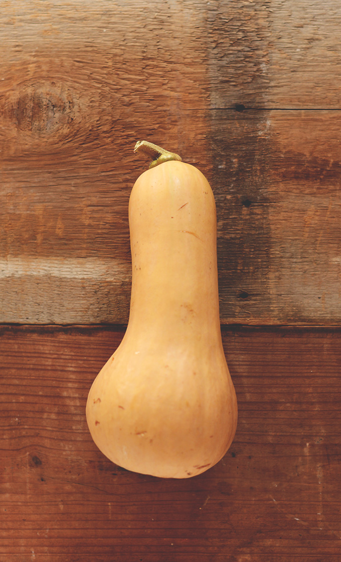 Fresh butternut squash ready to be cut open and roasted for salad