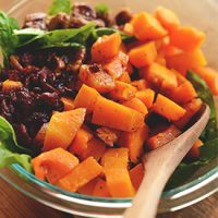 Glass bowl filled with Warm Roasted Butternut Squash Salad