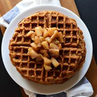 Top down shot of a plate stacked with Vegan Apple Cinnamon Waffles