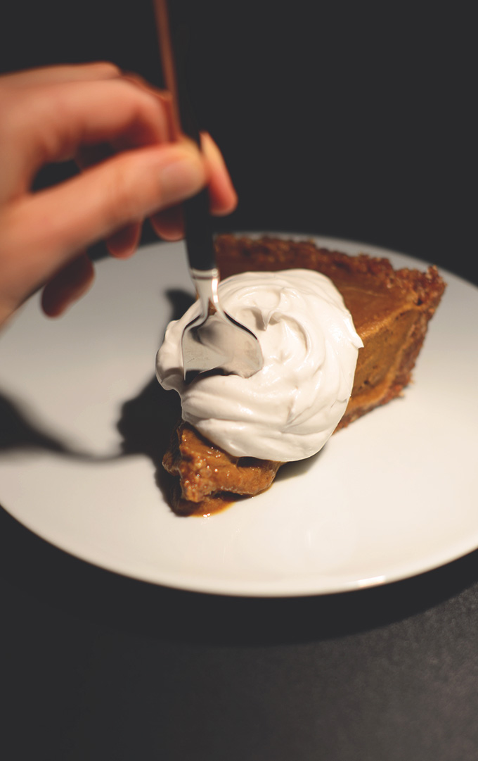 Grabbing a bite of Creamy No-Bake Vegan Pumpkin Pie topped with coconut whipped cream