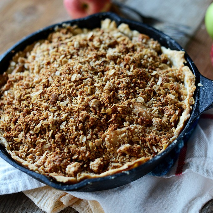 Skillet filled with vegan Deep Dish Apple Crumble Pie