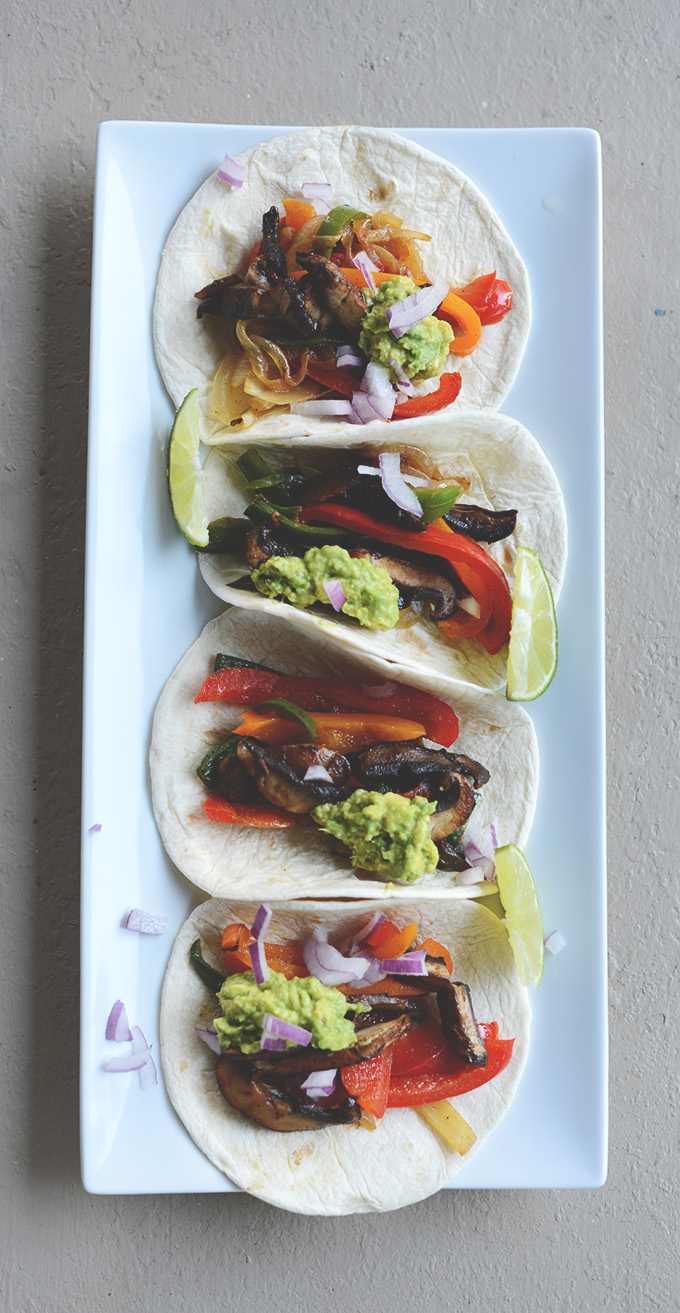 Platter of Easy Vegan Fajitas with lime wedges