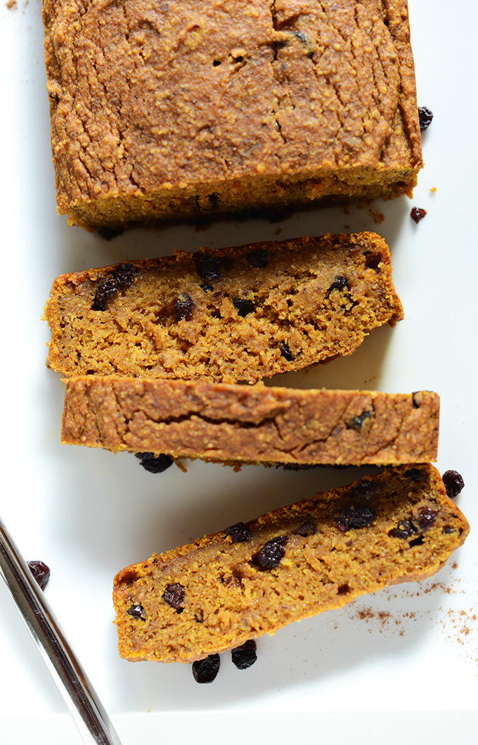 Partially sliced loaf of our Easy Vegan Pumpkin Bread made with dried currants