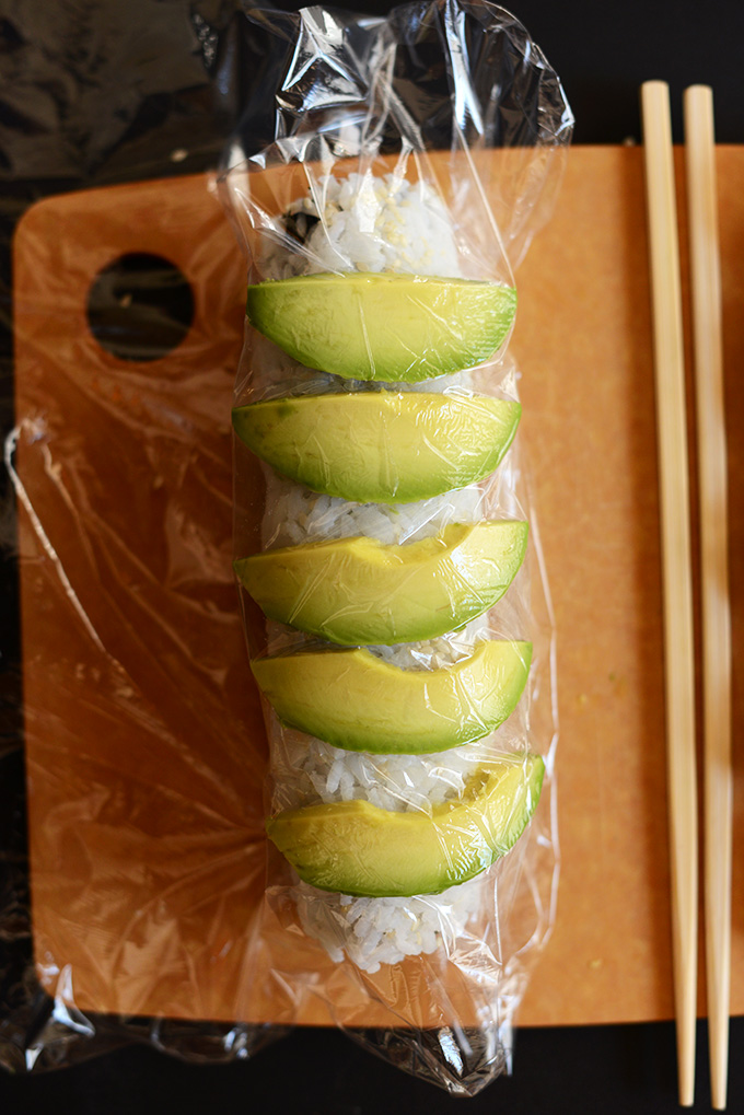 Showing how to roll an Inside Out Sushi Roll without a mat