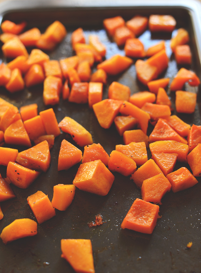 Baking sheet filled with freshly roasted butternut squash