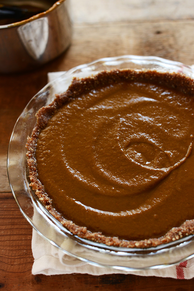 Pie pan filled with a batch of our gluten-free vegan No-Bake Pumpkin Pie recipe