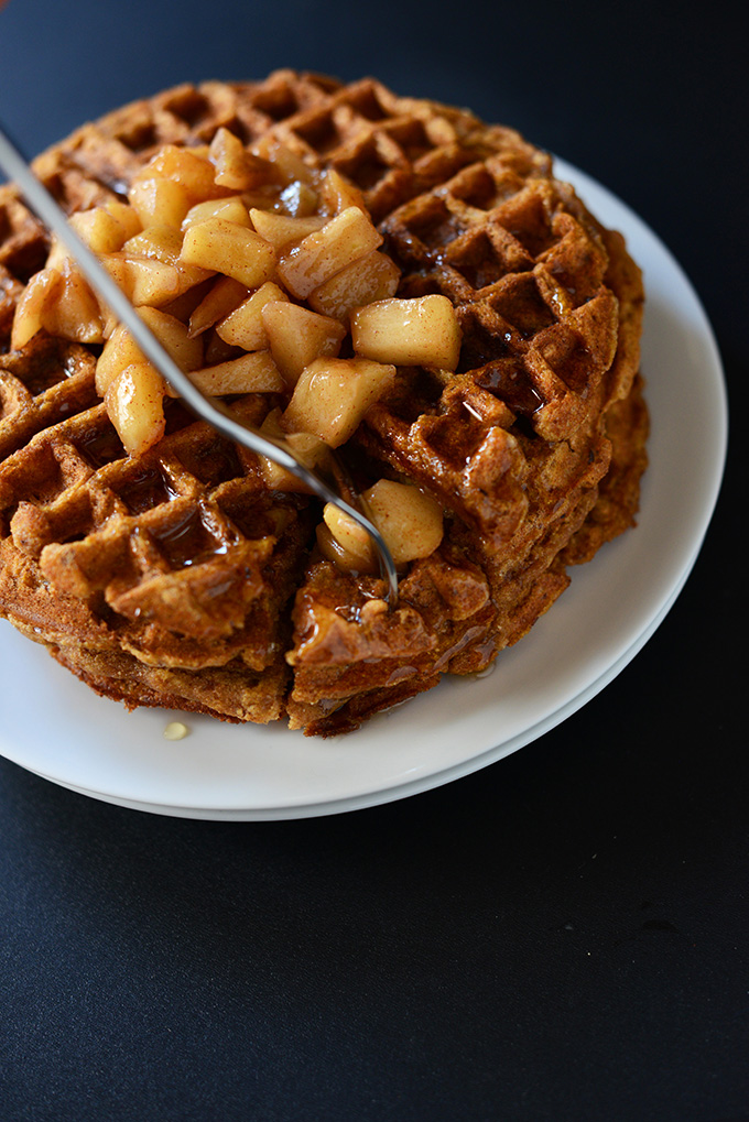 Grabbing a bite of Vegan Cinnamon Apple Waffles for a delicious breakfast
