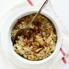 Spoon in a bowl of Creamy Eggplant & Caramelized Onion Dip
