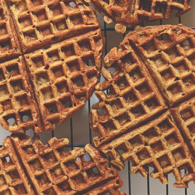 Batch of our Pumpkin Spice Latte Waffles recipe cooling a rack