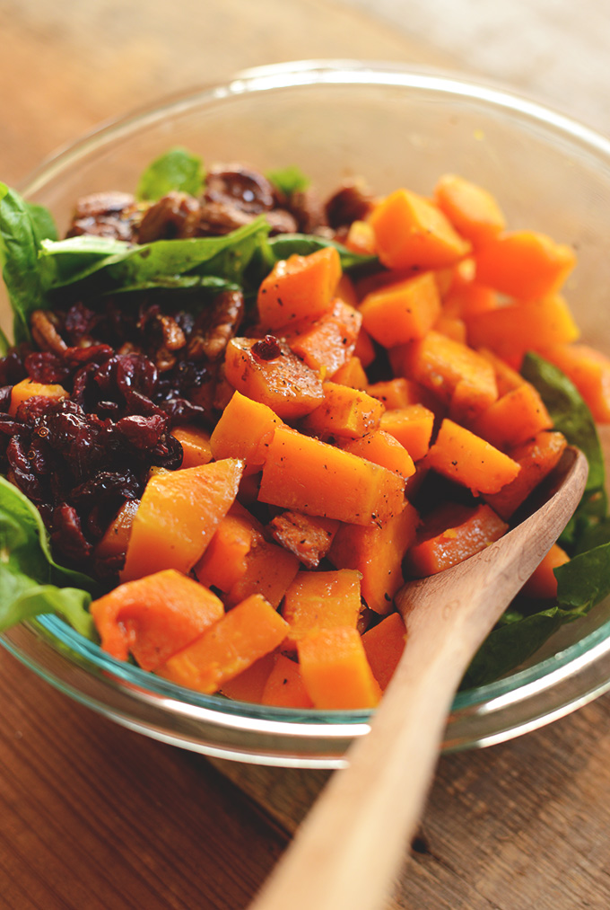 Big bowl of Roasted Butternut Squash Salad made with Spinach and Caramelized Pecans
