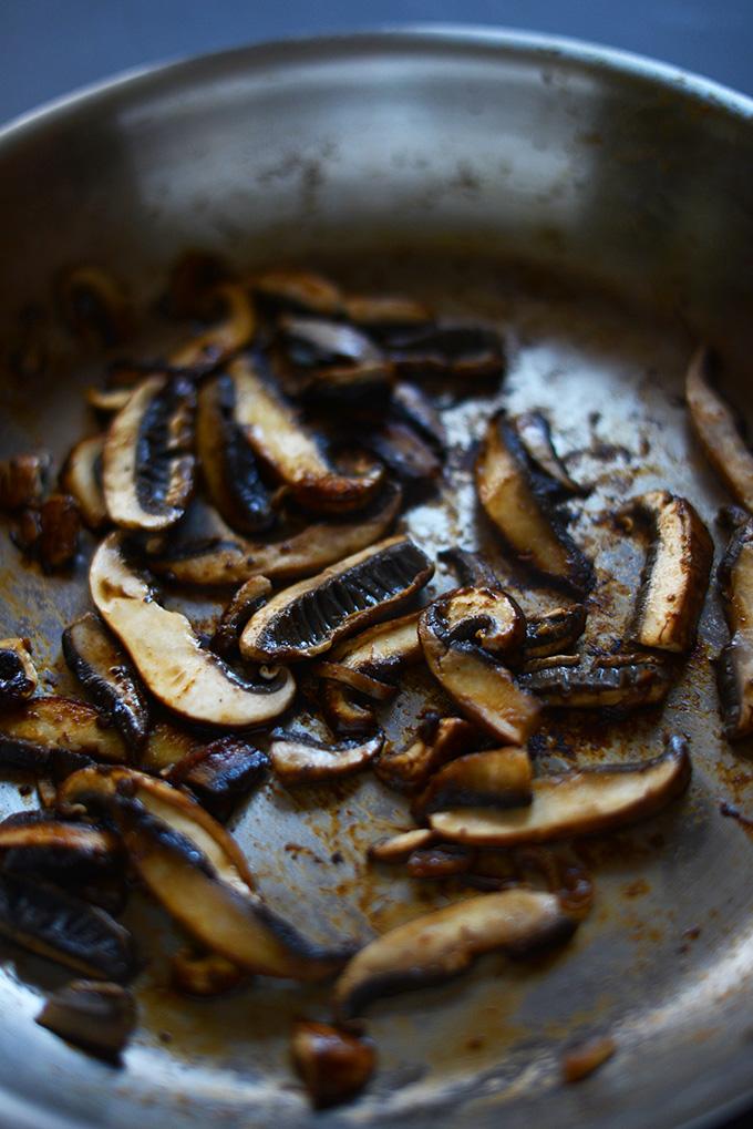 Skillet of sautéed portobello mushrooms for making vegan fajitas