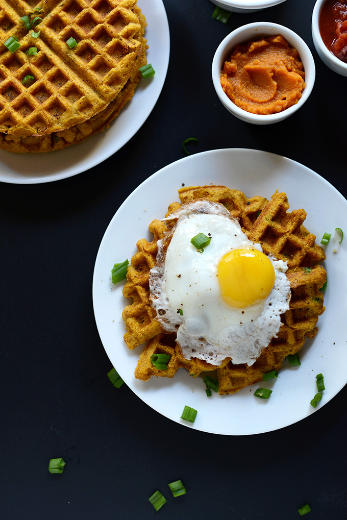 Plate of a Savory Pumpkin Cornbread Waffle topped with a fried egg