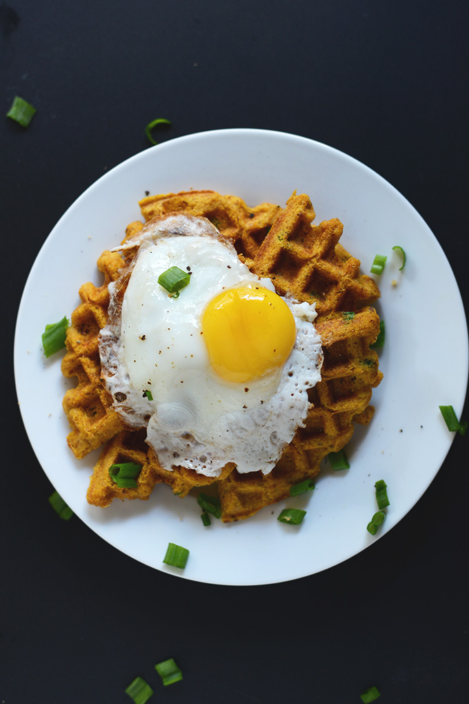 Plate with a Savory Pumpkin Cornbread Waffle topped with a fried egg