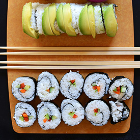 Sushi board with freshly rolled sushi made without a mat
