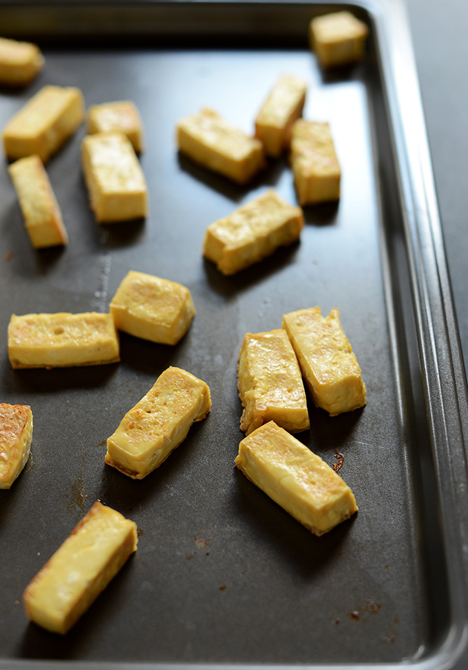 Baking sheet with strips of delicious baked tofu