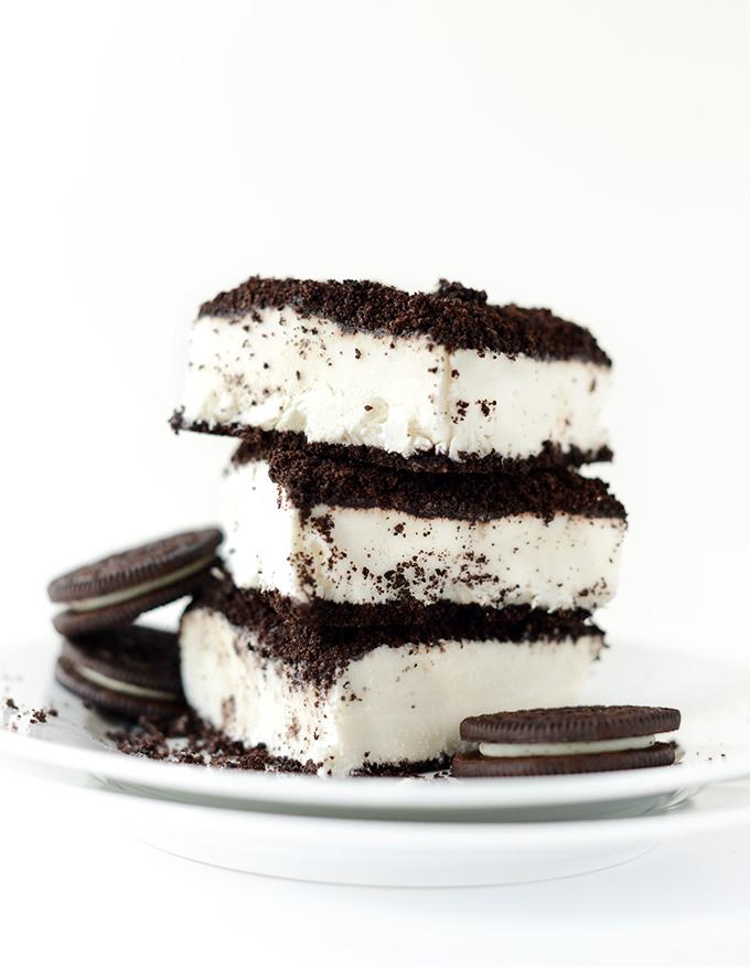 Stack of Vegan Dirt Cake slices alongside oreo cookies