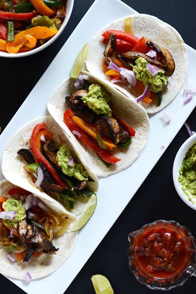 Platter of Vegan Fajitas topped with guacamole