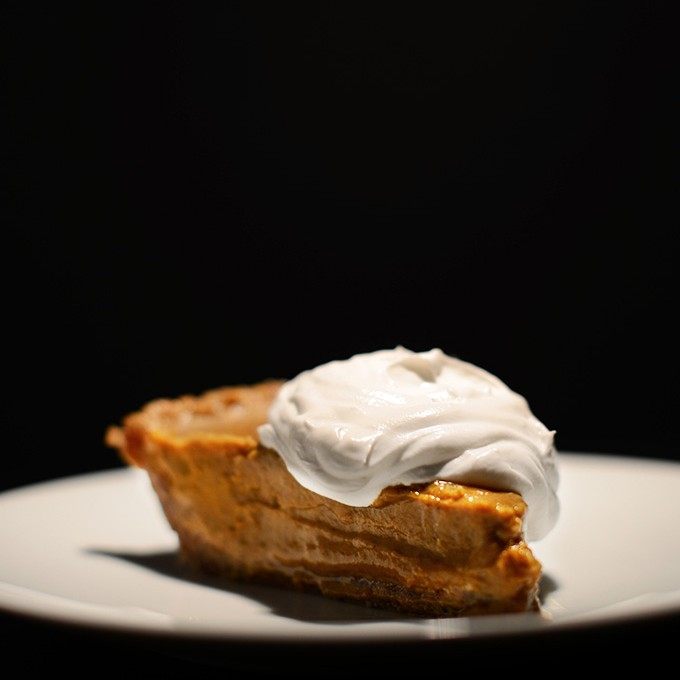 A slice of our Vegan No-Bake Pumpkin Pudding Pie recipe resting on a plate