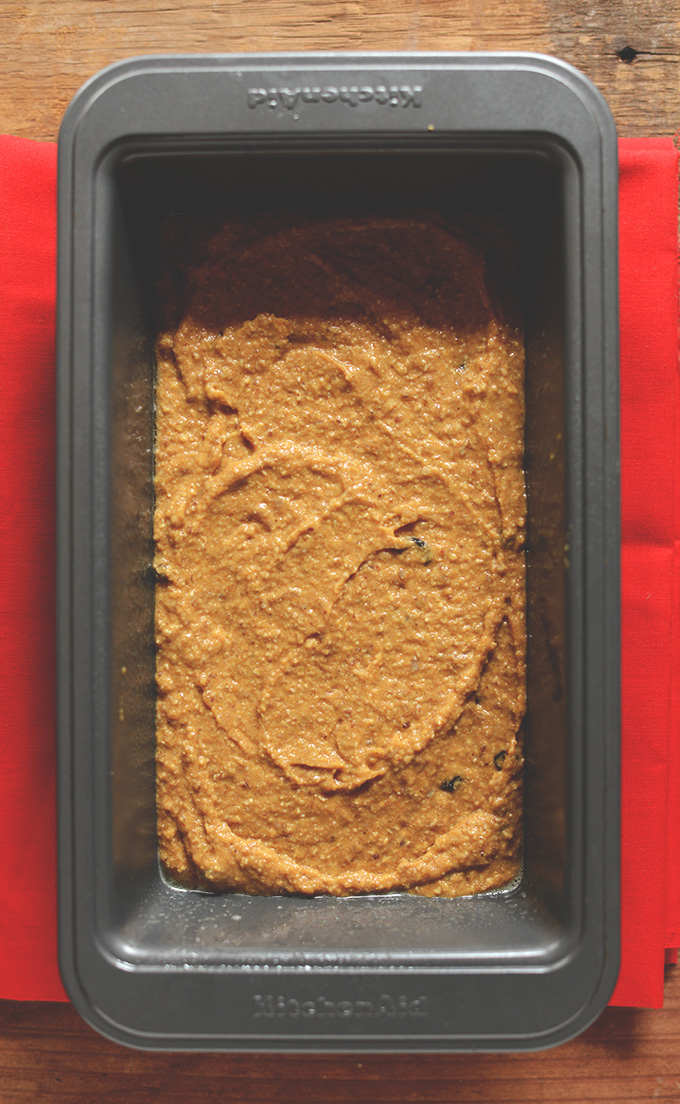Loaf pan filled with batter for our Vegan Pumpkin Bread recipe