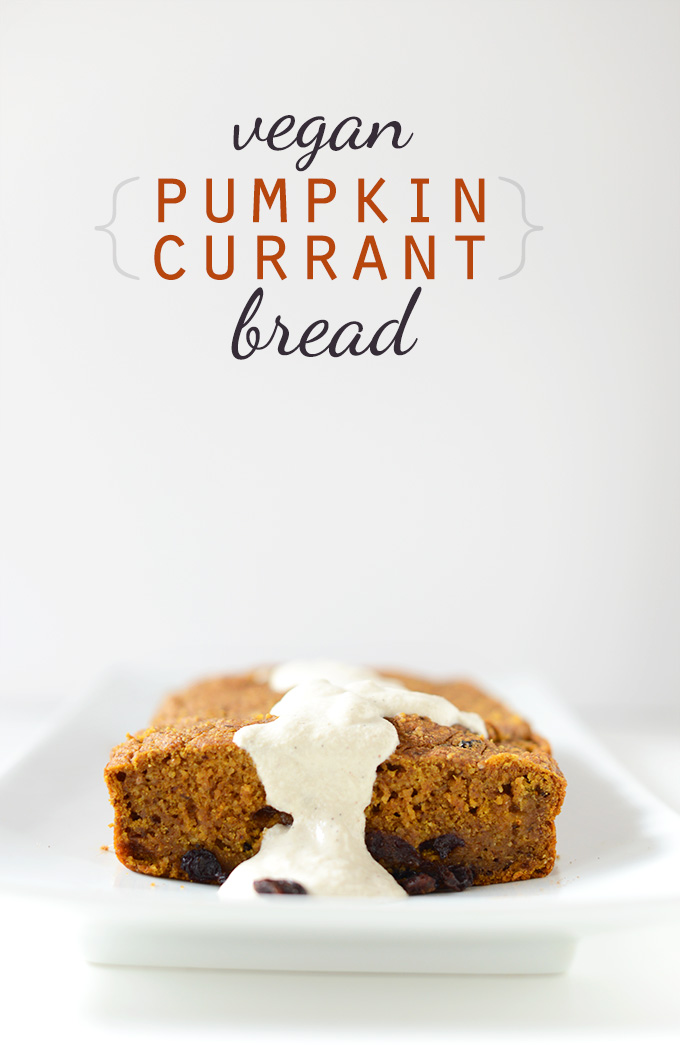 Loaf of Vegan Pumpkin Currant Bread with a drizzle of frosting