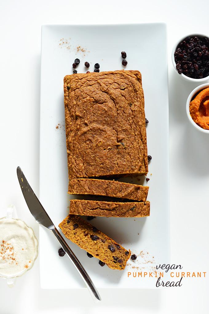 Partially sliced loaf of Vegan Pumpkin Currant Bread