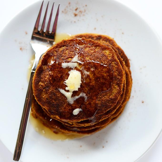 Fork resting on a plate alongside a stack of Vegan Pumpkin Spice Pancakes