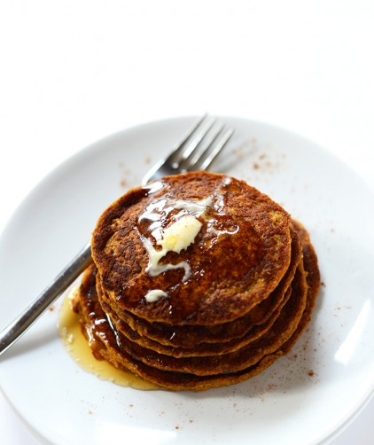 Stack of Vegan Pumpkin Spiced Pancakes topped with syrup and vegan butter