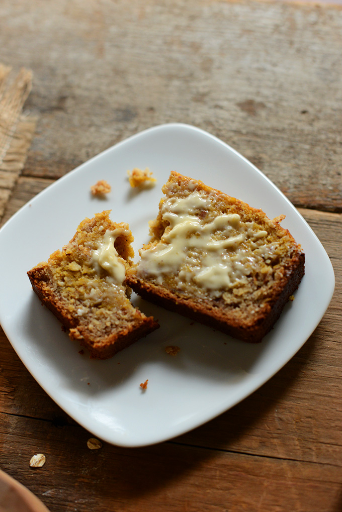 Plate with a slice of Butternut Squash Banana Bread smeared with butter