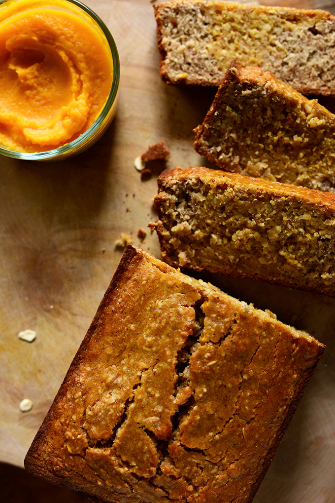 Partially sliced loaf of Gluten-Free Banana Bread with Butternut Squash Puree