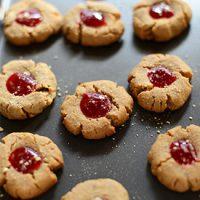 Baking sheet filled with Vegan PB&J Thumbprint Cookies