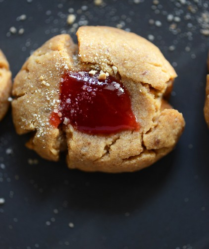 Close up shot of a Vegan Peanut Butter Cookie topped with a Jelly Thumbprint