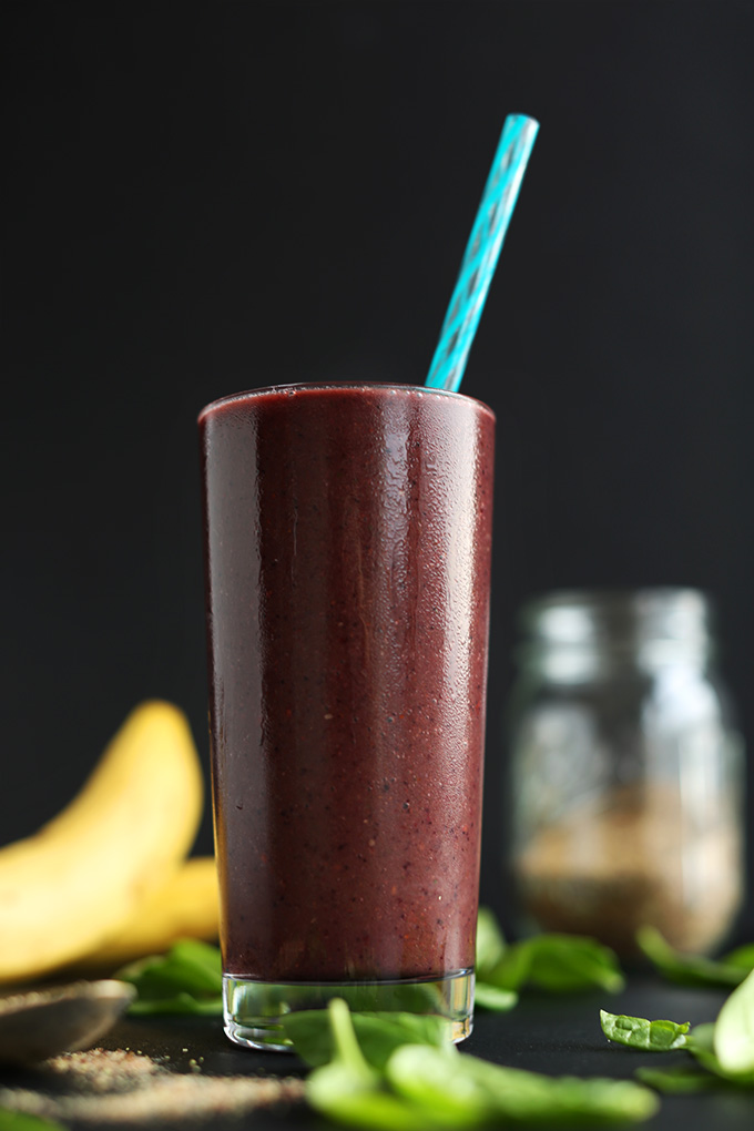 Tall glass of our simple vegan Detox Smoothie made with berries and banana