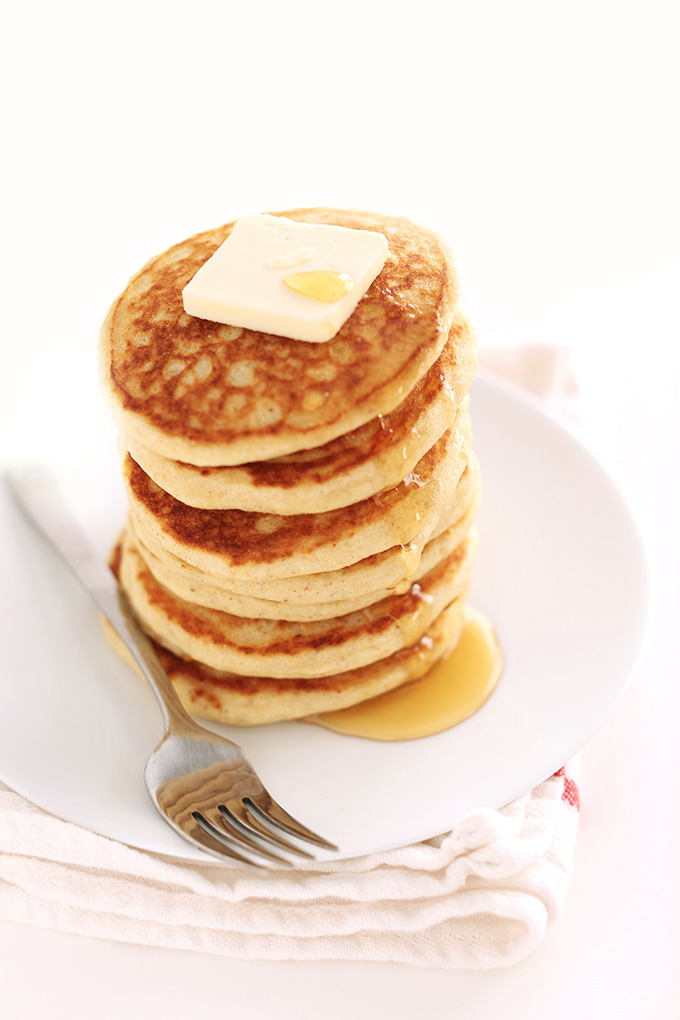 Stack of Fluffy Gluten-Free Pancakes topped with syrup and vegan butter